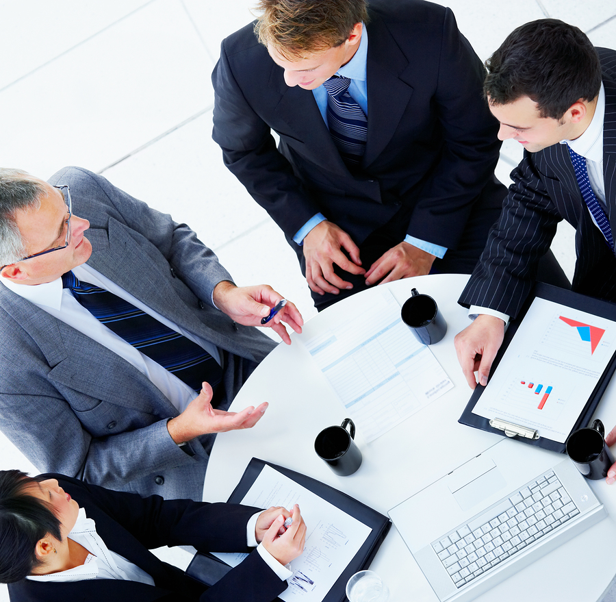 bigstockphoto_top_view_of_a_business_meeting_4913522-1